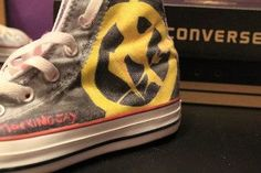 Hunger Game Converses ..i'd totally rock these