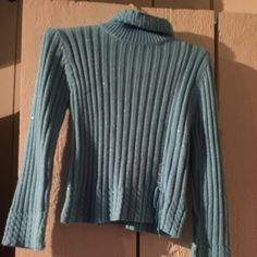 Blue sparkly sweater Beautiful blue sweater Euc.  Has a cute detail with a knot tied in the front.  Polo neck. Christie Brooks Sweaters