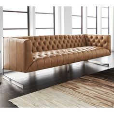 Shop Sunpan Imports  9498 Viper Sofa at ATG Stores in Peanut Nobility Bonded Leather and Metal(List Price $4,597.50 Price$3,387.00)