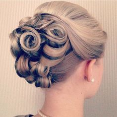 This bun looks like a rose and is super cute and elegant for any formal event you have planned!. Formal Hairstyles.
