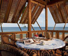 Design Chic - love the bermuda shutters for a beach house