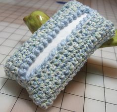Purse Tissue cover - This pattern is available as a free Ravelry download.  Here is a quick and easy tissue cover for those tiny tissue packs that you keep in your purse or glove compartment.