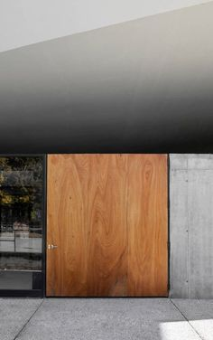 Love the combination of grey and brown, wood and concrete, warm and cold.: