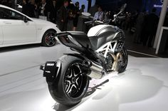 Ducati Diavel Carbon AMG Special Edition. The 2012 flagship model of the Diavel family is a tribute to the AMG luxury-sport brand and is intended for passionate connoisseurs of technology, engineering detail and exclusive style.