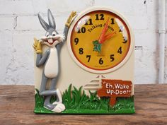 "Bugs Bunny Clock - 1974 Janex Looney Tunes Alarm Clock - I got this for Christmas when I was in Kindergarten.  It said something like ""Eh, Wake up Doc!  When you get up, I'll go back to bed."""
