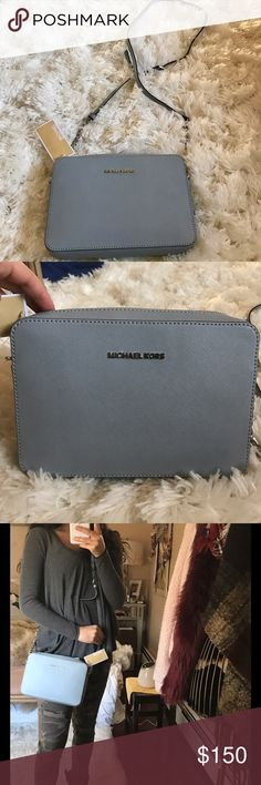 Michael Kors Cross Body This bluish-steel grey color is so in right now! Perfect cross body for summer/spring. Adjustable strap. 100% authentic!😊👜 Michael Kors Bags Crossbody Bags