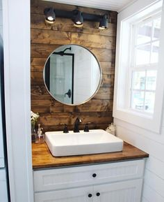 Stained wood walls behind the bathroom sink and bedroom loft add warm touches of color.