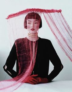 Magical Thinking; photo by Tim Walker; Jacob K, stylist; with Xiao Wen Ju // W Mag, March 2012. {Lanvin top; stylist's own fan worn as hat; Angels the Costumiers necklace; Shaneen Huxham gloves.}