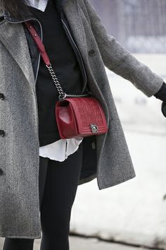 """This mini """"Boy Chanel"""" bag in lipstick red adds a feminine touch to this mens style double-breasted coat."""