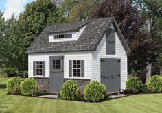 """12'x16' Vinyl Roof: Charcoal Gray  Trim: Dark Gray  Siding: White Options: 8' Transom Dormer, 3' High Stone Front, 36"""" 6-Lite Wood Door, 36"""" Door on Second Floor, Elite Double Doors   This one has an attic pull-down stairway for more storage space on first floor.  www.AmishShedsNewJersey.com"""