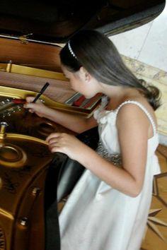 Emily Bear signing the piano (Life Ball)