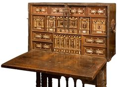 16th century Spanish Renaissance Vargueno - used from Pinterest. The vargueno was a writting desk where one side folded down for a writing base and exposed drawers that were used to hold utensils. It was not attached to the base as it had a handle on each side and could be carried from place to place while traveling.