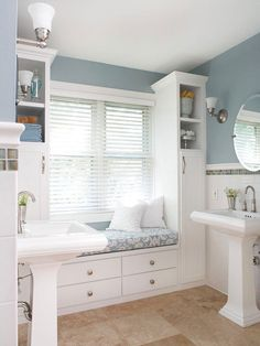 A cozy window seat occupies the footprint of a never-used jetted tub. More bathroom renovations on a budget: http://www.bhg.com/bathroom/remodeling/makeover/budget-bathroom-remodels/