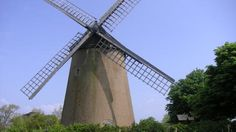 The four huge sails stand still on Bembridge Windmill, Isle of Wight