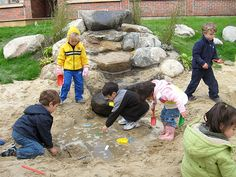 Outdoor water play with sand.