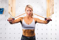Chest press with resistance band - IMAGE - Women's Health and Fitness magazine