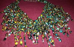 Multi-colored, multi-tiered, glass beaded necklace, costume piece, adjustable clasp by RAVsLostAndFound on Etsy