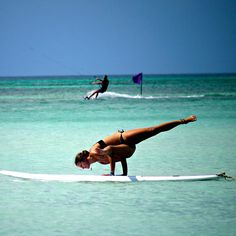 yoga on the water! have to try this on my next beach vacation!