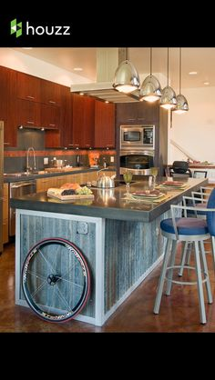 Use different textured materials- corrugated iron on the breakfast bar and smooth worktop... SO cool!