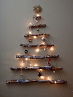 I made this wall Christmas tree from pine branches.  I used a little white paint, some twine, pinecones, lights and decorations.