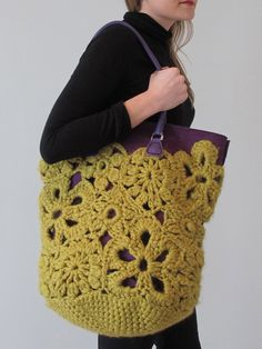 Four of Erika's favourite crochet motifs are made and 'meshed' together in a freeform fashion to create an over-scaled lace-look tote bag. Made in 'Erika Knight' maxi wool and on a big hook, this piece is great worked in a fashion 'pop' colour. Lined with contrasting colour felt and contrasting colour leather handles to create a vibrant look and professional finish. Size: 38cm Tall x 30cm Diameter