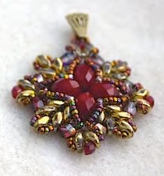 This listing is for a .pdf file containing instructions to how to make a beadwoven pendant that can also be used as earrings. Difficulty level: beginner, suitable for anyone with none, or little experience in beadweaving. Instructions contain a list of materials and step-by-step