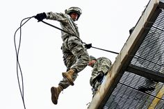 Missouri National Guardsman Cadet Andrew Cully leaps from the top of the rappel tower during part of the Guard's first Air Assault School on Camp Crowder.