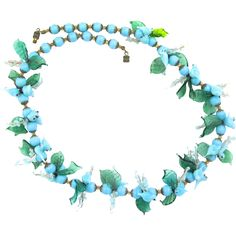 Vintage Venetian Italy Blue Glass Birds Necklace: The vintage Venetian glass bird and fruit necklaces of Murano glass are simply fabulous! This one is higher end, with 16 clusters that generally consist of 2 light blue birds, 2 green leaves, 2 light blue berry vines and two round, light blue beads that have been individually wired. There are more light blue beads at each end, so that the necklace is comfortable around your neck. It is difficult to find these necklaces, and when you do, they…