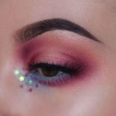 Reflective stars and blue mascara.