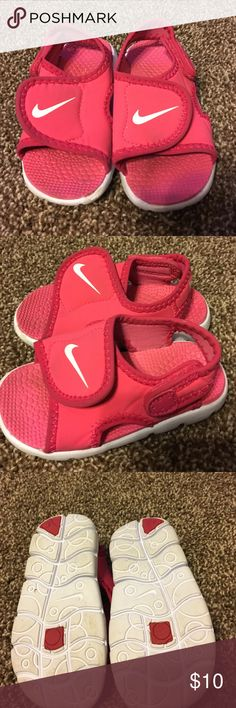 Size 6 c girl's toddler size Nike water shoes Really comfortable pair of pink and white Nike water shoes/flip flops - size 6 toddler Nike Shoes Water Shoes