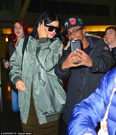 Fan friendly: Kylie showed her soft side as she took a photo with an adoring onlooker