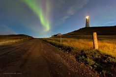 The First Act - first to shoot to check the aurora has its advantages... you get a chance to test shoot the first burst. here is the grotto lighthouse with the northern lights over the reykjanes peninsula using the car headlamps to illuminate the ground.