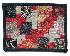 Hand-stitched/embroidered 12-patch with crosses, by Morna Crites-Moore. Striking, thoughtful piece.