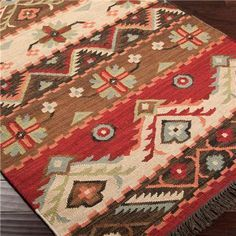 I really like the warm rich colors of this Native Blanket Flatweave Wool Kilim Rug