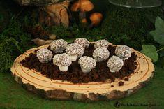 Marshmallow mushrooms in edible dirt.  http://www.thefabulousmomsguide.com/2012/05/woodland-dessert-table/