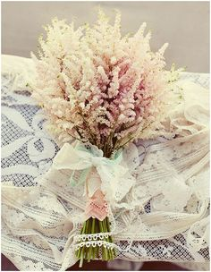 Simple but effective – this bouquet of feathery blush-pink astilbe is perfectly complemented by its lace stem-wrap. The colour and texture are perfect for classic vintage look and have a long season, from April to November.