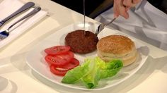 """Scientists took cells from a cow at an institute in the Netherlands & turned them into strips of muscle that they combined to make a patty. One food expert said it was """"close to meat but not that juicy"""" & another said it tasted like a real burger. Researchers say the technology could be a sustainable way of meeting what is a growing demand for meat. Is it just me or is this creepy? If they can grow muscle from cells to create a patty, what else will they be creating in labs for us to eat?"""