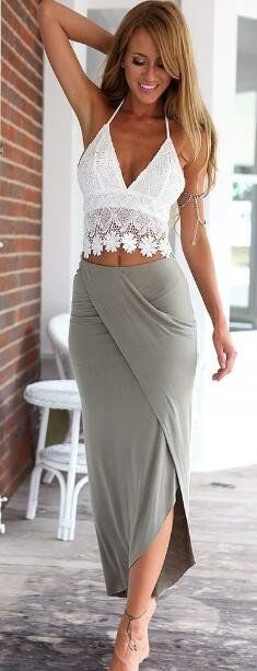 Be prepared to make a statement this season in the lovely two piece dress. Halter crochet lace top and irregular skirt make it so sweet. Expose your body in the sun.Pick it up at Romoti.com