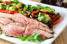 Flank Steak and Warm Brussels Sprouts Salad with Bacon Vinaigrette Recipe Salads, Main Dishes with flank steak, olive oil, garlic cloves, chili powder, ground cumin, worcestershire sauce, soy sauce, brown sugar, brussels sprouts, applewood smoked bacon, balsamic vinegar, honey, salt, ground black pepper, red bell pepper, unsalted almonds, fresh parsley