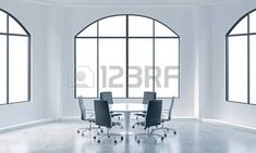 A conference room in a modern office with white copy space in windows. White table and black chairs. 3D rendering. photo