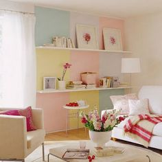 Love the pastel color blocks and white couch.
