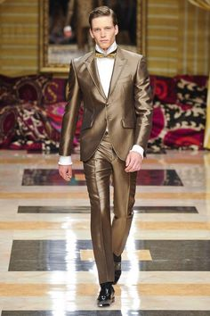 View all the catwalk photos of the Carlo Pignatelli spring / summer 2013 showing at Milan fashion week.  Read the article to see the full gallery.