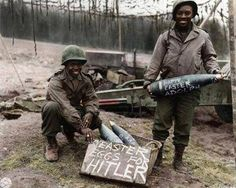 Two American soldiers proudly show off their personalized 'Easter Eggs', northeast France, during Easter, 1945 http://historicalphotographs.net