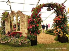 The judges presented Peter Beales' Roses exhibit with a Silver-Gilt Medal, pictured inside The Festival of Roses Marquee, at the RHS Hampton Court Palace Flower Show Hampton Court Flower Show, Rhs Hampton Court, Garden Arbours, Judges, Real Flowers, Arches, Exhibit, Palace, Entrance
