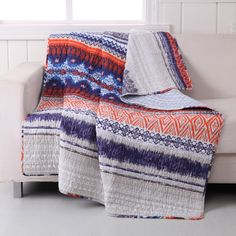 Blend into your urban jungle with this edgy bohemian throw. Bands of tribal art, primitive crosses and seismic stripes etched into a stark color palette add mystery to your personal legend. Made from
