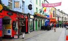 Galway city at the west coast of ireland view of shop street, a very busy pedestrian street in galway, a popular shopping, dining and partying area photo West Coast Of Ireland, Mother Daughter Trip, Visit Dublin, Erin Go Bragh, Shops, Shopping Street, Irish Traditions, Ireland Vacation, Emerald Isle