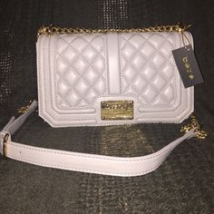 Reasonable offer!NWT bebe quilted faux leather bag NWT bebe quilted faux leather bag. Gorgeous with gold hardware. Strap is adjustable so that you can wear as a crossbody. Beautiful quality bag that you will love! Classic light gray color. Reasonable offers are ALWAYS welcomed and appreciated!  bebe Bags Shoulder Bags