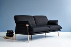 monica förster's savannah sofa for erik jørgensen features handcrafted wood frame wrapped in saddle leather