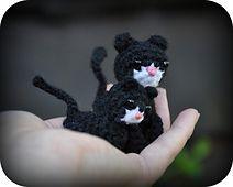 Cat and kitten.