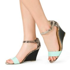 This mid-heel wedge has two trends in one: snakeskin detail and a pop of pastel.